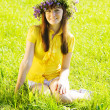 图库照片: Girl on meadow grass