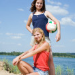 Girls posing with volleyball — Stock Photo