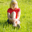 Girl in red at meadow — Stock Photo