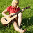 Stock Photo: Blonde girl with guitar