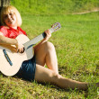Stock Photo: Girl plays her guitar
