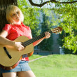 Teenager girl with guitar — Stock fotografie