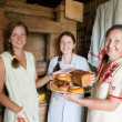 Stock Photo: Women with farm-style meal