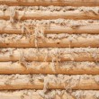 Wall from wooden logs — Stock Photo