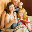 Royalty-Free Stock Photo: Family reading an interesting book