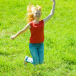 Jumping red-haired teen girl - Stock Photo