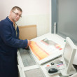 Stock Photo: Printer checking print run