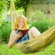 Girl reading book on hammock — Stock Photo #3585436