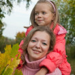Woman with daughter  in fall — Stock Photo