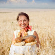 Eldery woman with bread — Stock fotografie