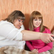 Stock Photo: Women changing channels
