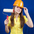 Girl with paint rollers — Stock Photo
