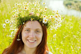 Girl in camomile wreath — Stock Photo