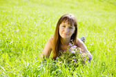 Girl at summer meadow — Stock Photo