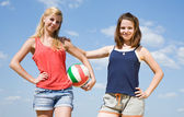 Sporty girls with volleyball — Stock Photo