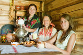 Women nea traditional russian samovar — Stock Photo
