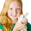 Girl with pet rabbit — Stock Photo #3814574