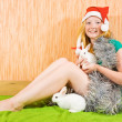 Girl in new year decoration with  rabbits - Stock Photo