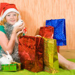 Girl with Christmas gifts — Stock Photo #3814608