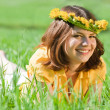 Sweet girl rest on the grass — Stock Photo