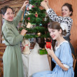 Stock Photo: Family decorating Christmas tree at home