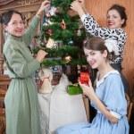 Family decorating Christmas tree at home — Stock Photo