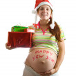 Pregnant woman with christmas gifts — Stock Photo