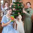 Family decorating Christmas tree at home — Stock Photo #3816284