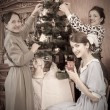 Vintage photo of Family decorating Christmas — Stock Photo
