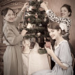 Vintage photo of Family decorating Christmas — Stock Photo #3816300