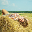 Stock Photo: Girl on fresh straw