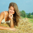 Stock Photo: Young womon hay bail