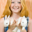 Girl with two pet rabbits — Foto de stock #3816824