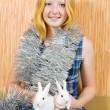 Foto Stock: Girl in clinquant with two rabbits
