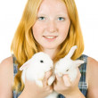 Girl with pet rabbits — Foto de stock #3817143
