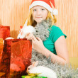 Stock Photo: Girl with two pet rabbits