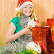 Foto Stock: Girl in new year decoration with rabbits