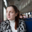 Female passanger sitting inside train - Stock Photo