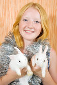 Teen girl with two rabbits — Stock Photo