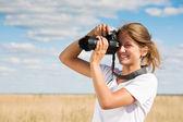 Girl taking photo — Stock Photo