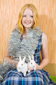 Girl in clinquant with two rabbits — Stock Photo