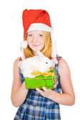 Girl in santa hat with rabbits — Stock Photo