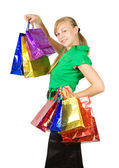 Happy girl holding shopping bags — Stock Photo
