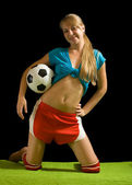 Sexy female football player — Stock Photo