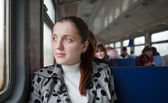 Female passanger sitting inside train — Stock Photo
