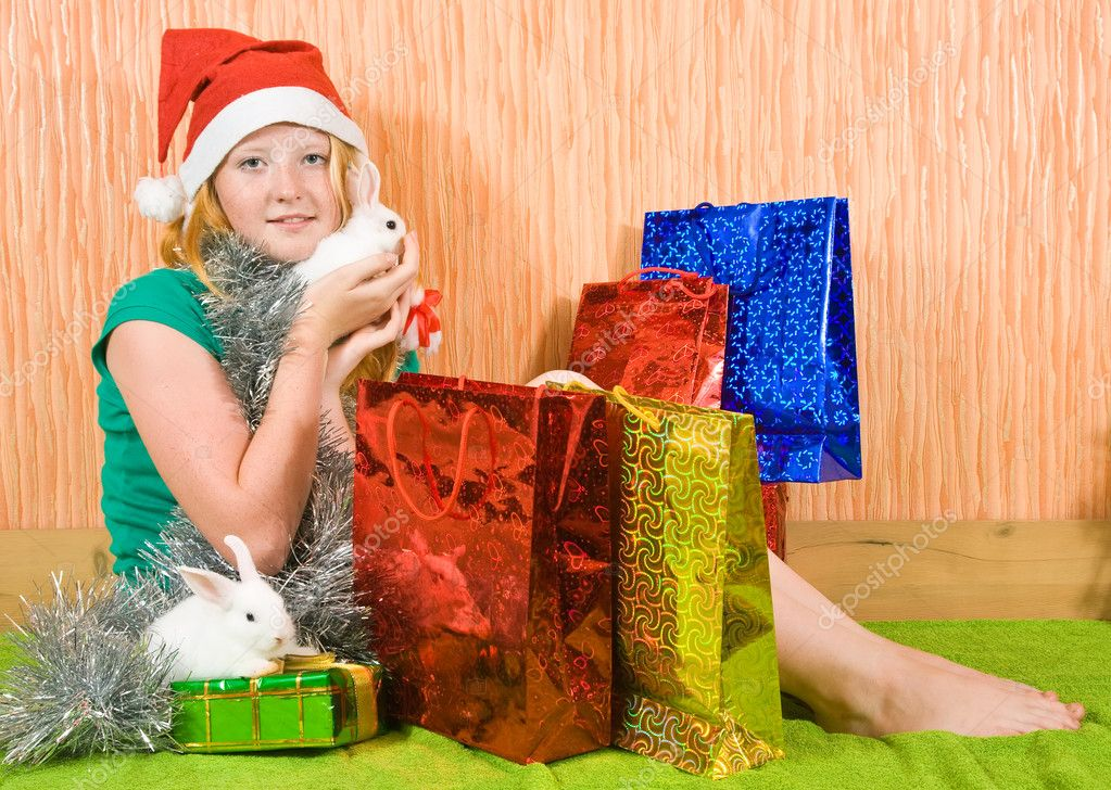 Teenager girl   with Christmas gifts and two pet rabbits  — Stock Photo #3814608
