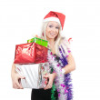 Blonde girl with few coloured gifts — Stock Photo
