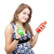 Long-haired girl with  toilletries spray — Stock Photo