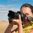 Stock Photo: Woman photographer with camera