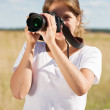 Girl taking photo with camera — Stock Photo